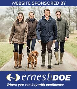 Ernest Doe logo, two women and two men walking in wellies, with a brown spaniel